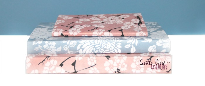 Books covered in pretty washi paper at Castle View Academy homeschool