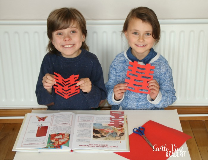 Castle View Academy makes a double happiness paper cutout
