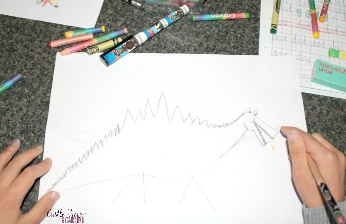 Learning to draw a dragon at Castle View Academy homeschool