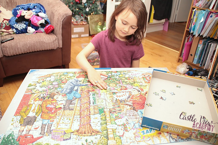Castle View Academy works on a Ravensburger Christmas jigsaw puzzle