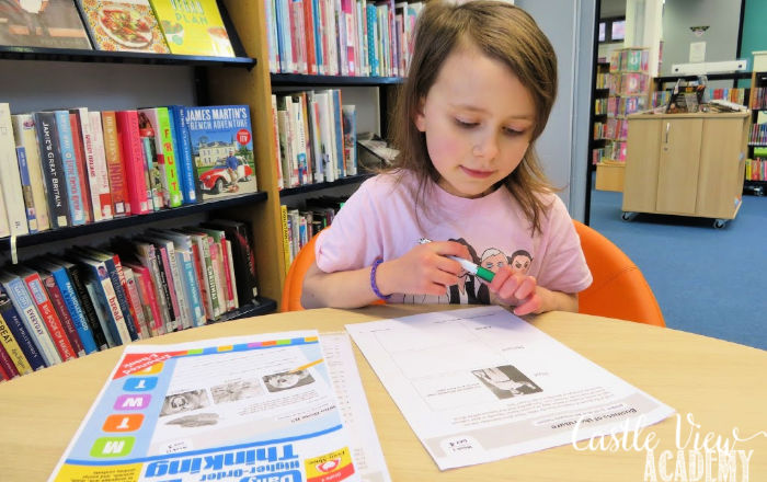 Castle View Academy homeschool works on higher-level thinking at the library