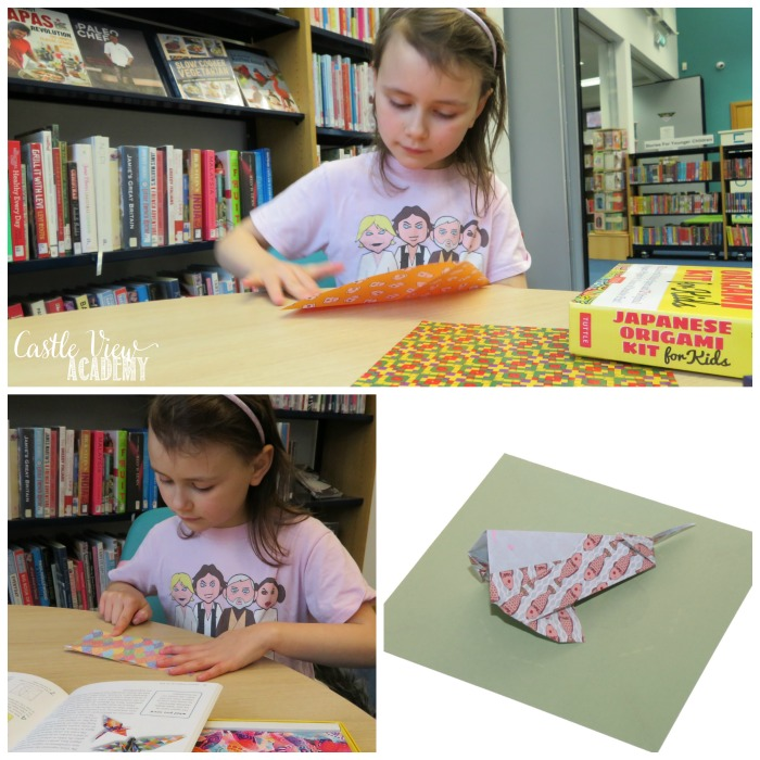 Folding an origami koi at Castle View Academy homeschool