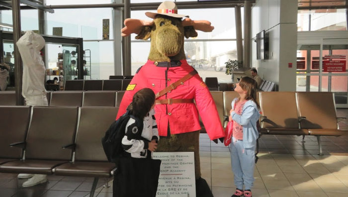 Arriving in Regina at YQR airport with the RCMP Moose Mascot