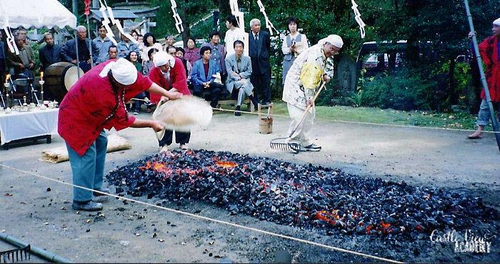 Raking and fanning the flames before firewalking
