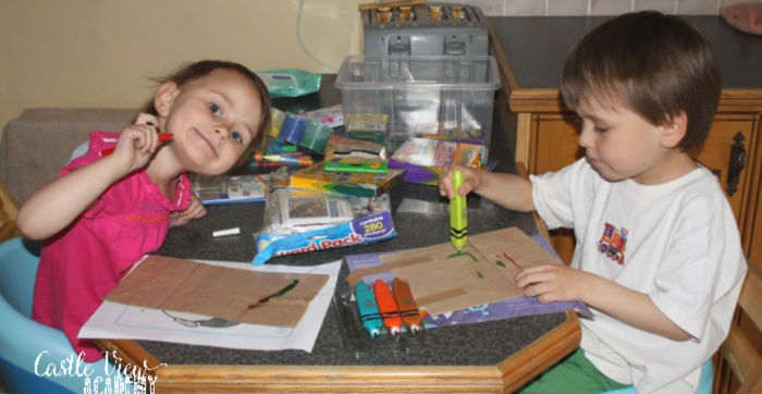 Painting surprise activity bags at Castle View Academy homeschool