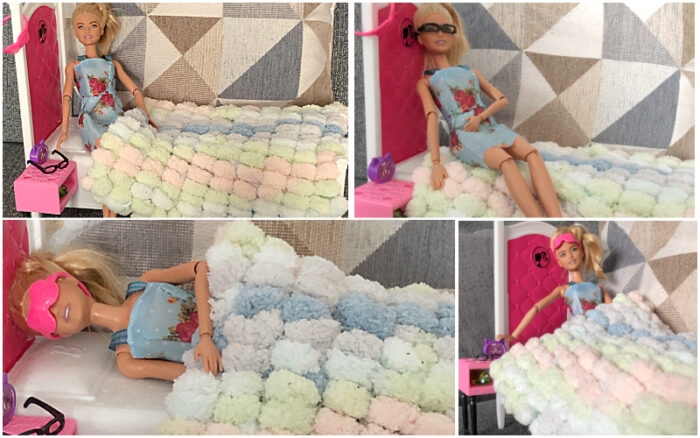 Small doll blanket from pompom yarn for kids who love crafts
