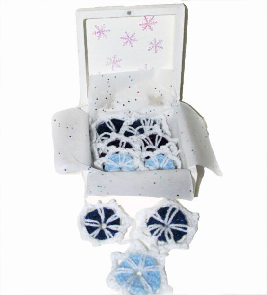 Wooden box and crocheted snowflakes
